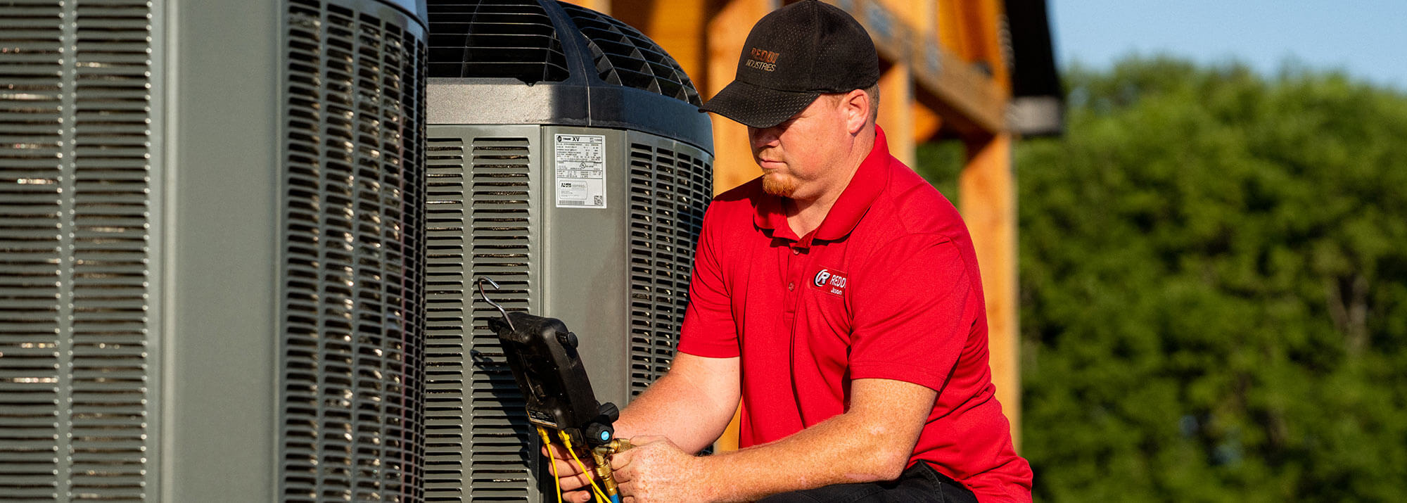 Heating and Cooling Tech Fixing Air Conditioner
