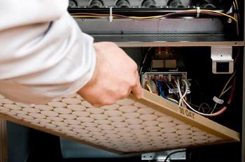 Man Changing Furnace Filter